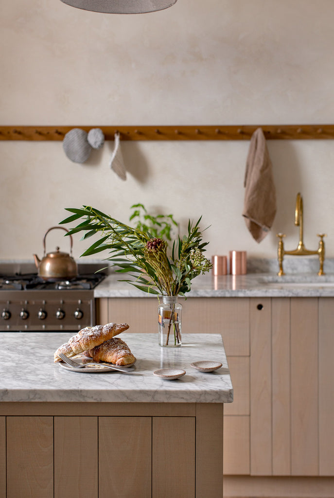 Natural kitchen with textured wood and marble