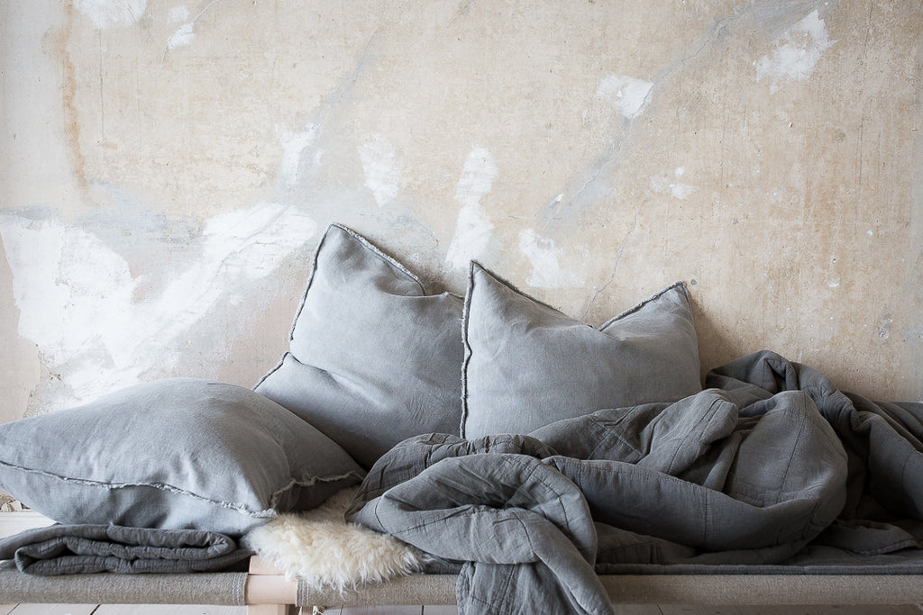 INGREDIENTS LDN grey linen cushions and simple grey quilt on daybed