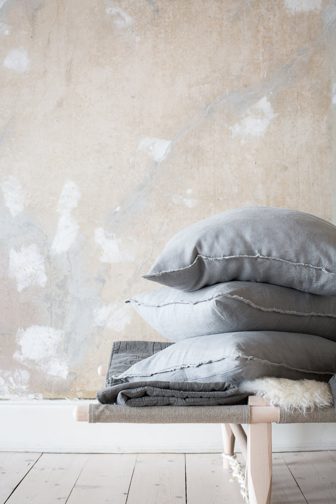 INGREDIENTS LDN stacked grey linen pillows