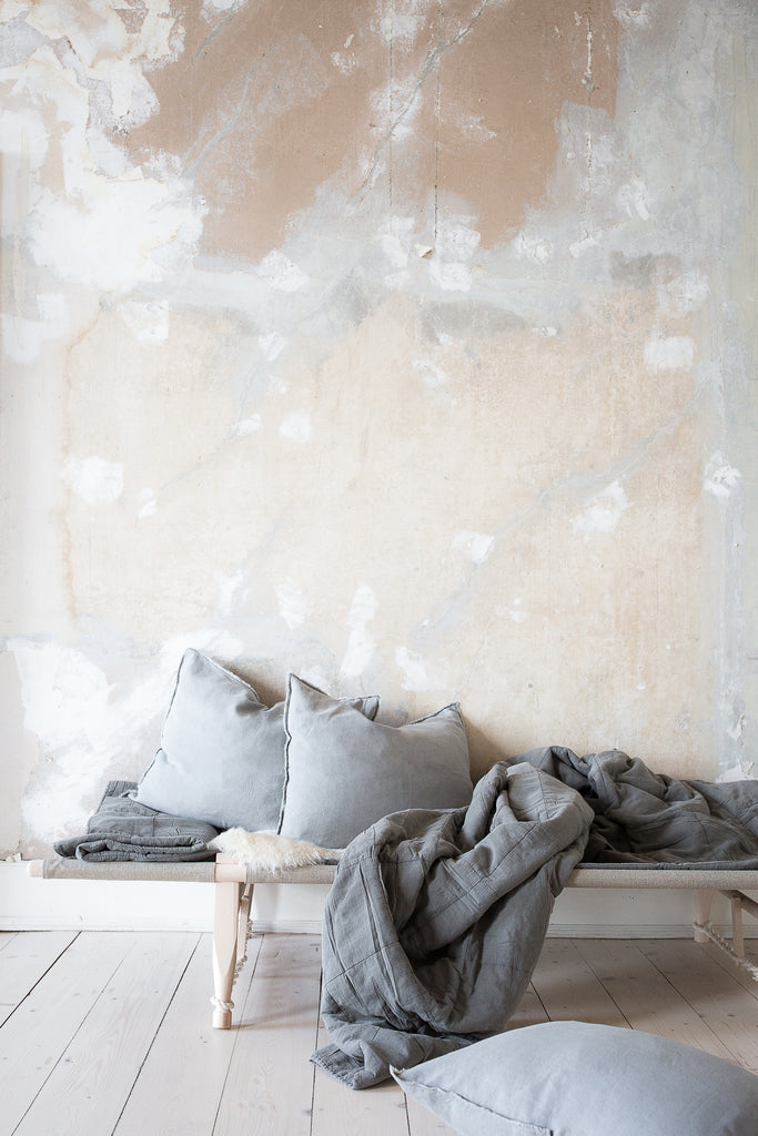 INGREDIENTS LDN distressed plaster walls and cozy daybed