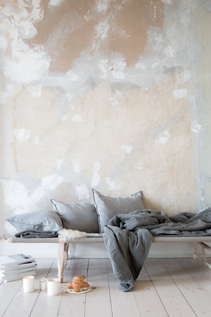 INGREDIENTS LDN distressed walls and daybed with grey cushions