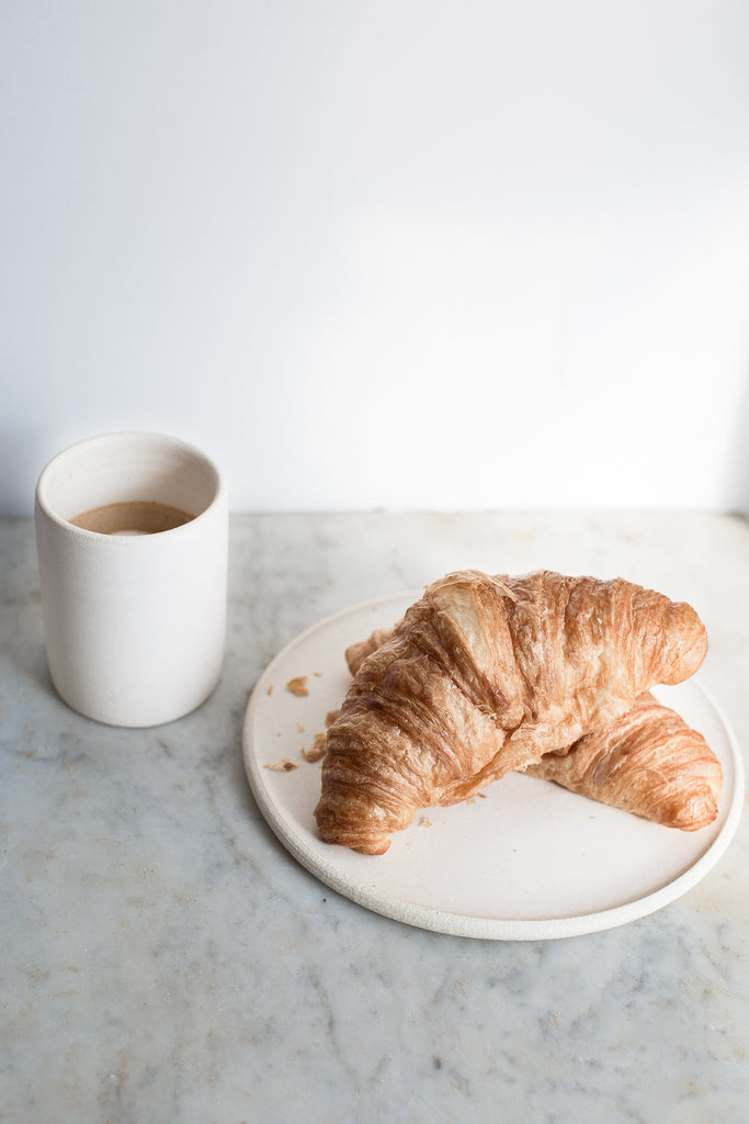 INGREDIENTS LDN simple ceramic plate with croissants and small coffee cup