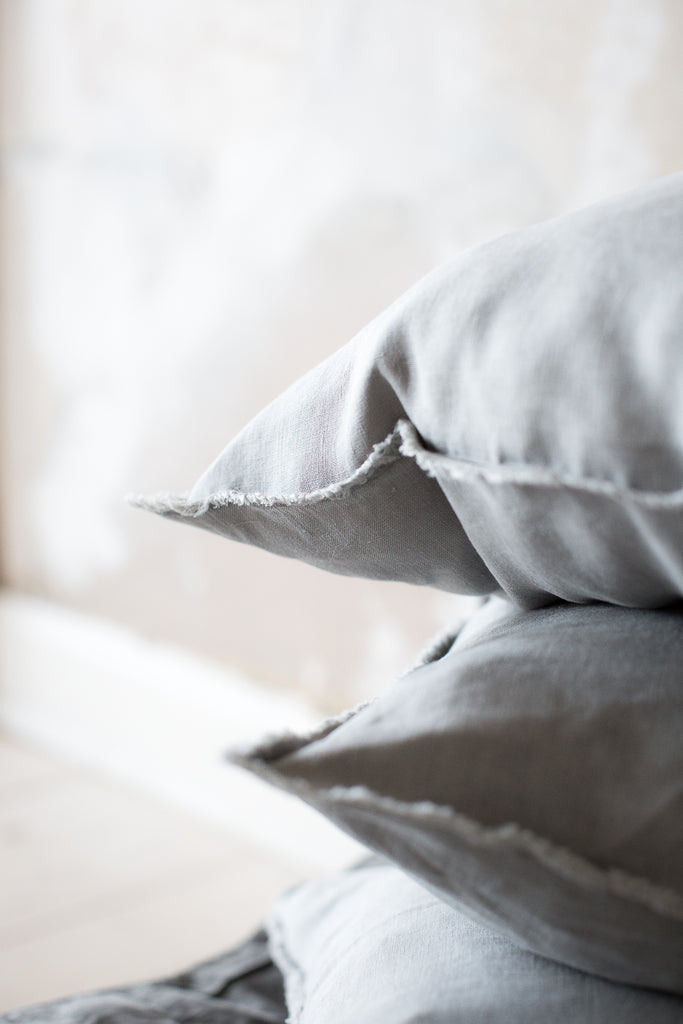 INGREDIENTS LDN stacked up grey linen cushions