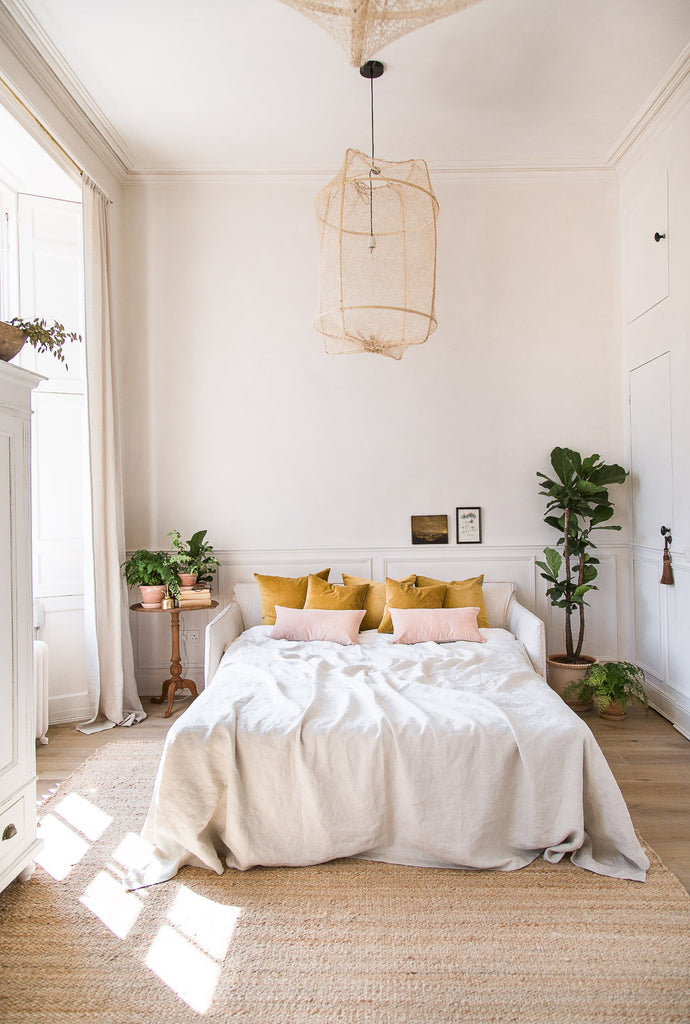 modern vintage bedroom decor in mustard yellow and pink velvet and neutral colours and linen