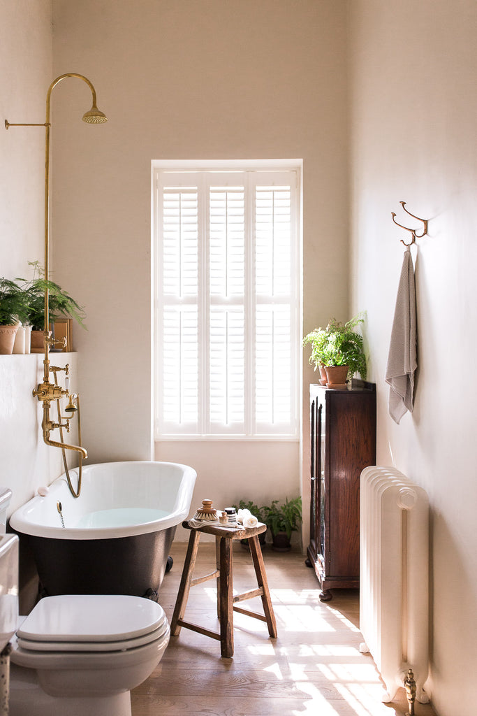 modern vintage bathroom with clawfoot bath tub