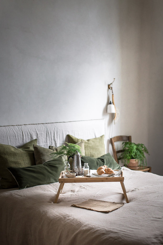 breakfast in bed with linen bedding