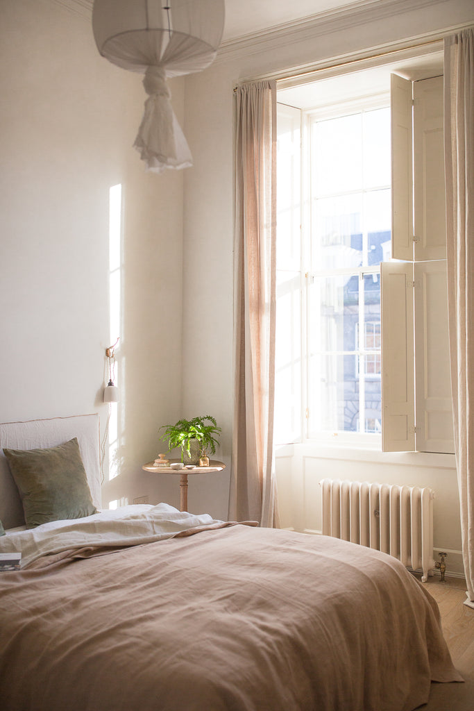 sunny bedroom with natural calming decor and soft colours