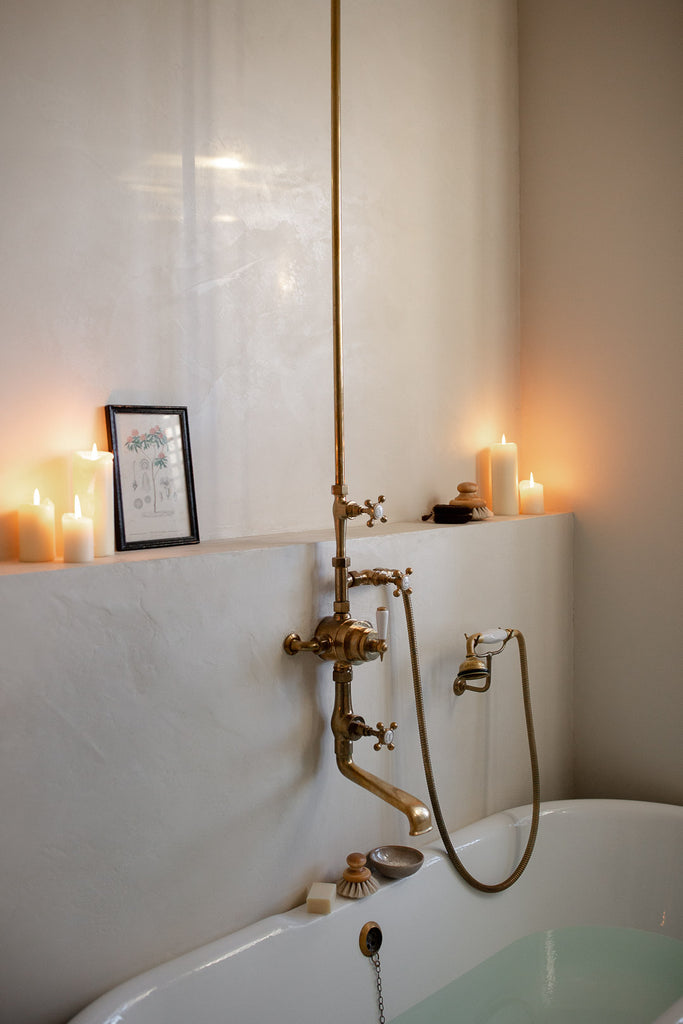 natural bathroom with brass taps