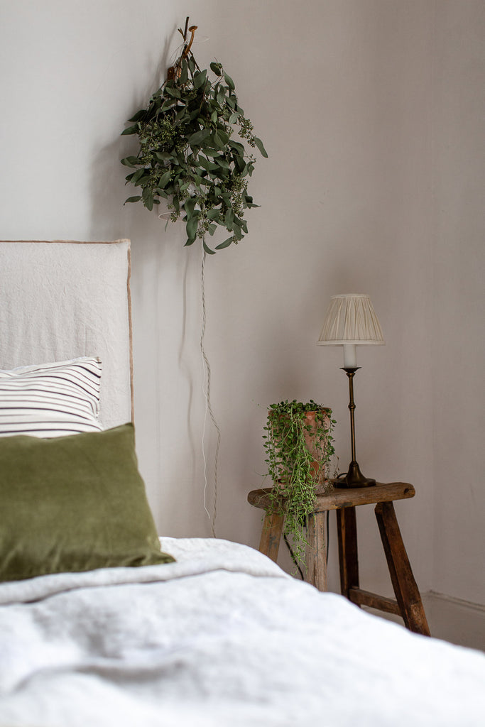 natural bedroom with linen in cream and green