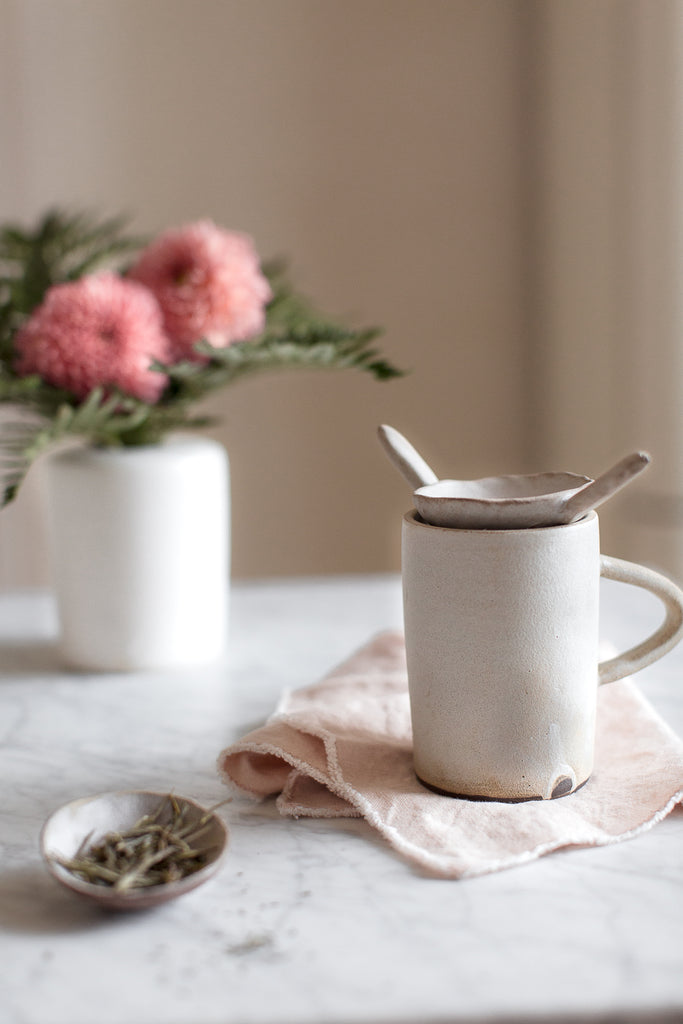 marble, linen and handmade ceramic tea cup in soft grey and pink