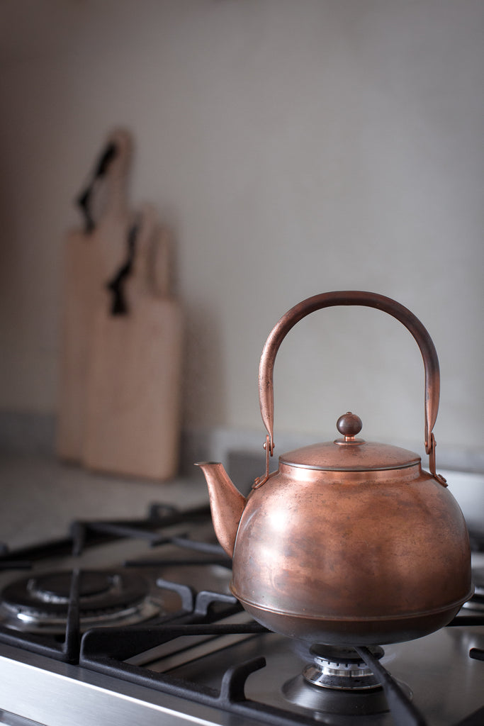 copper kettle with a patina