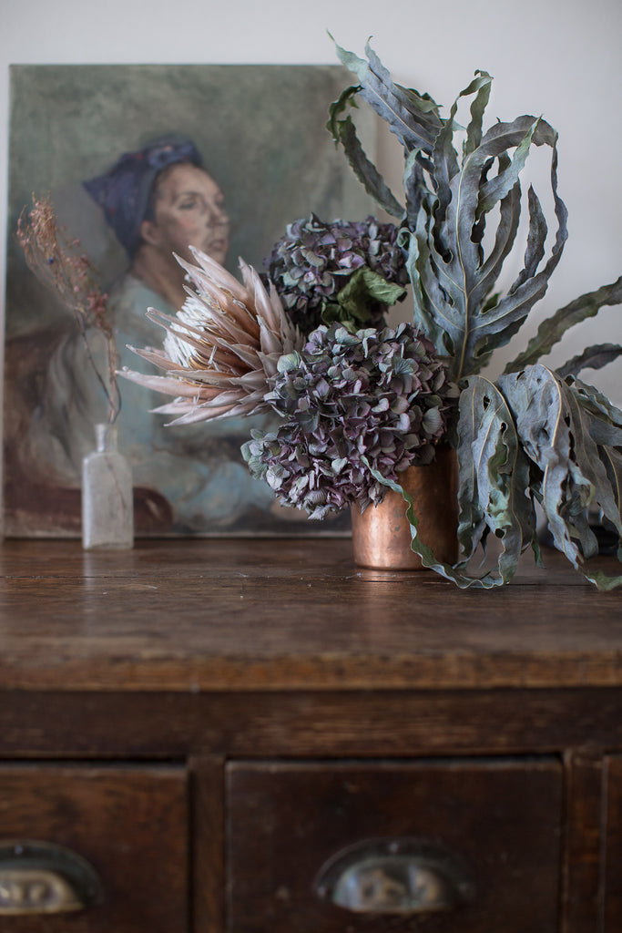 copper vase and dried flowers