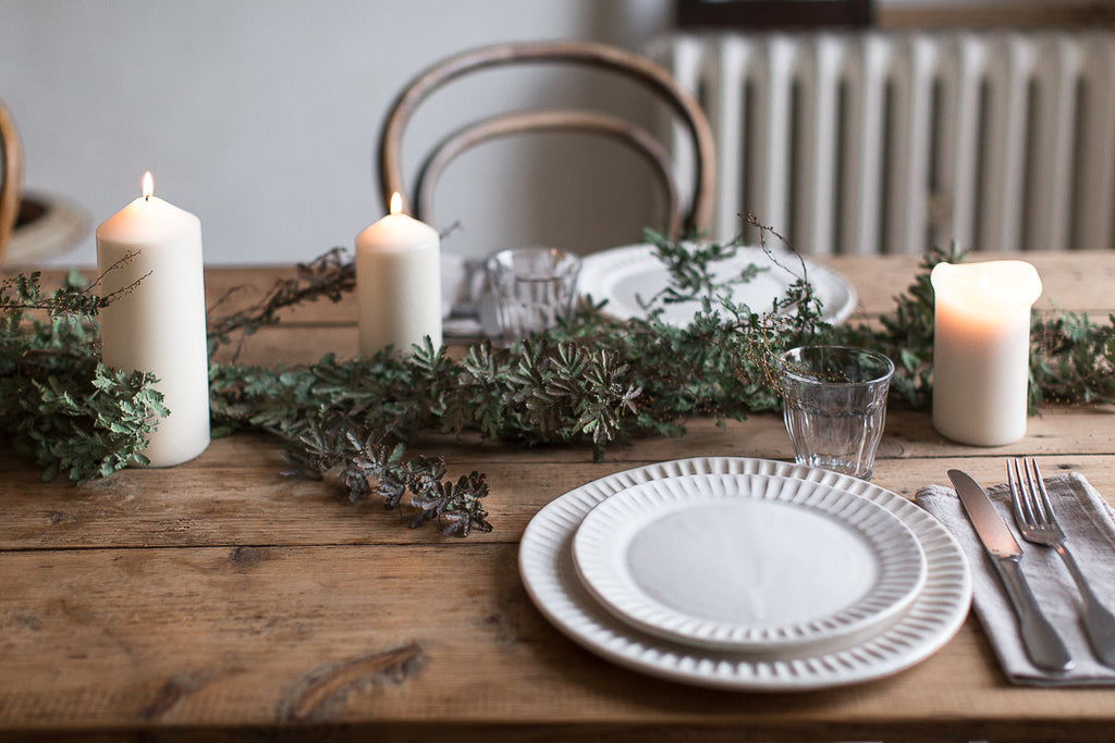 table decor with handmade ceramic plates and candles