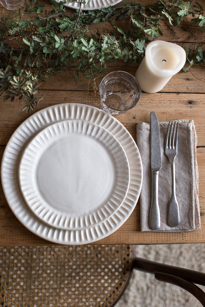 fluted organic handmade plates and vintage cutlery