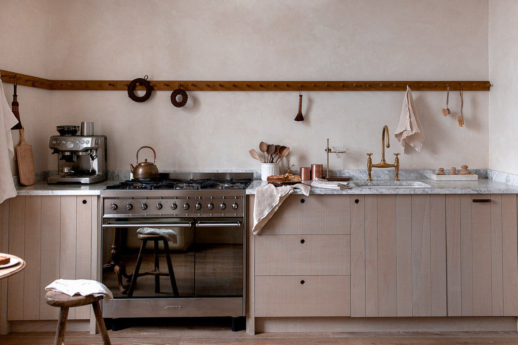 natural wood kitchen with marble
