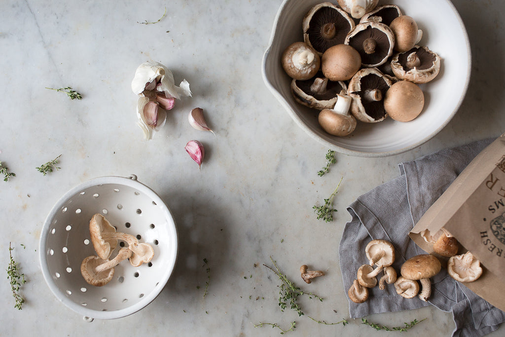 INGREDIENTS LDN pouring mixing bowl with mushrooms