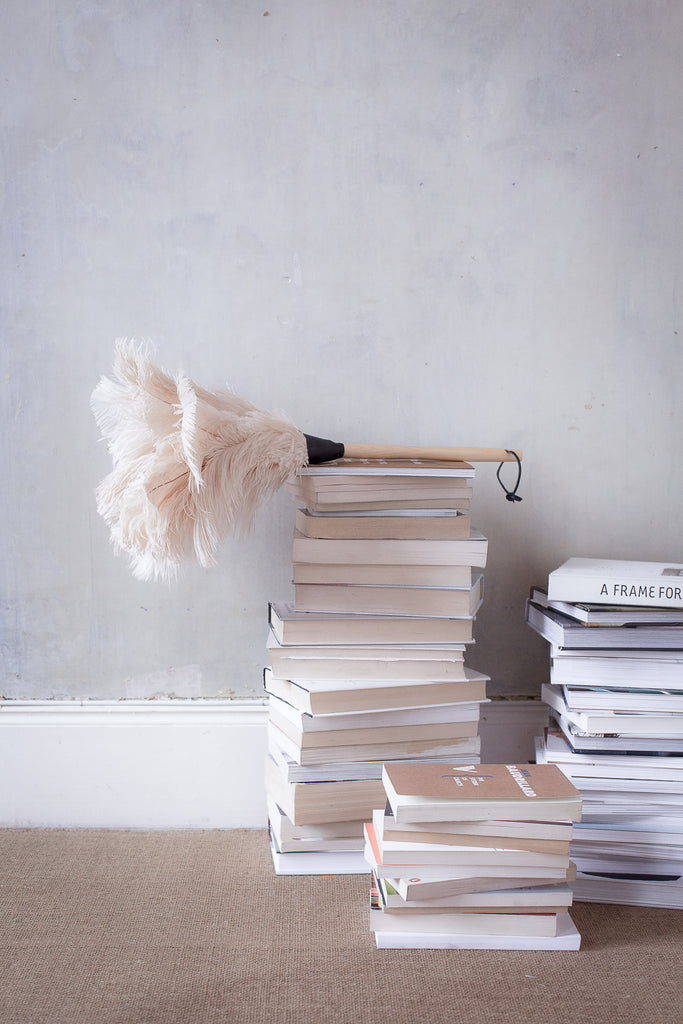 INGREDIENTS LDN Stack of books and feather duster