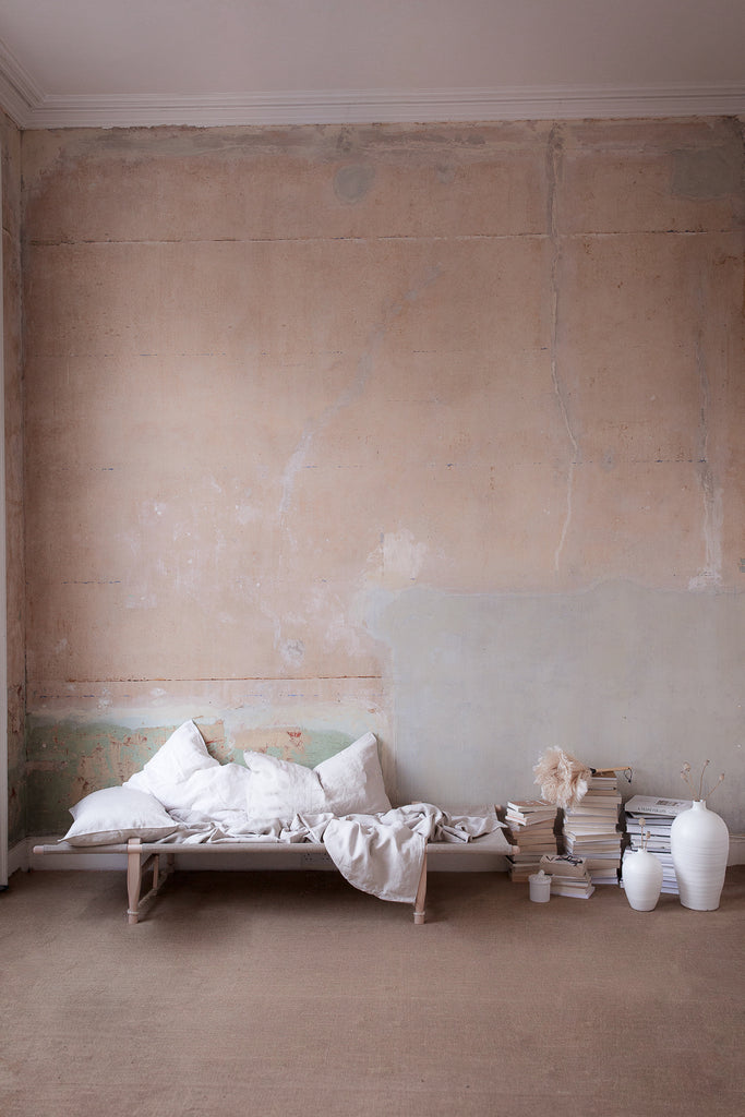 INGREDIENTS LDN Bedroom plaster walls and book stack