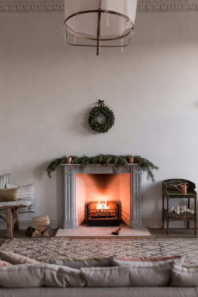natural winter home decor by the fire