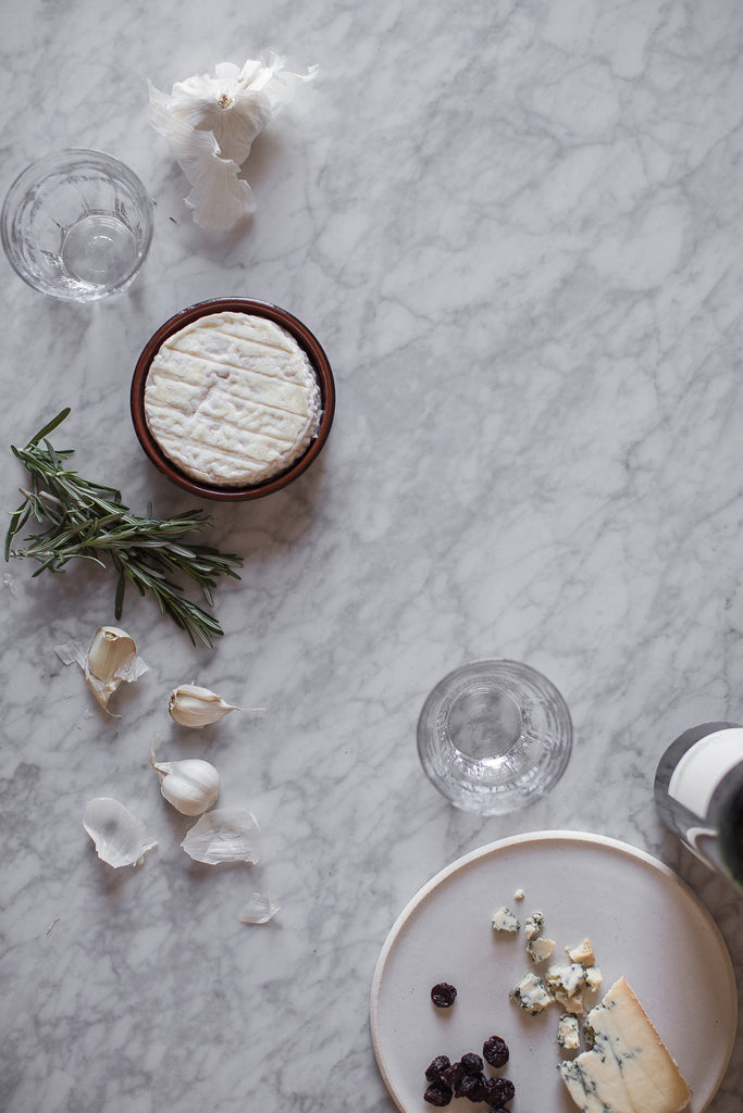 Winter wine and cheese on marble