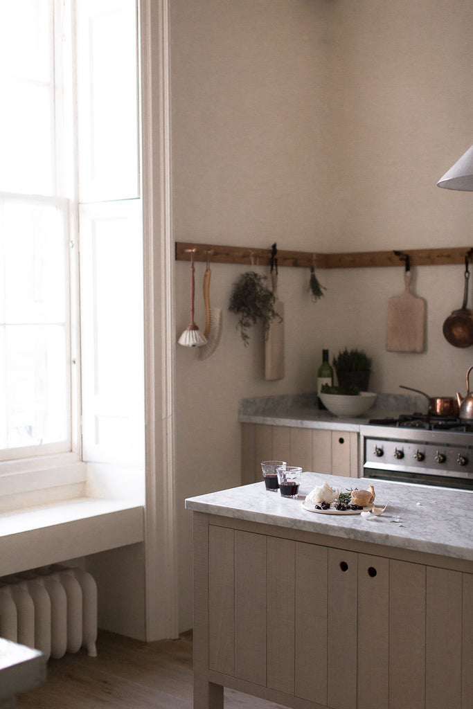 natural wood and marble kitchen with large window