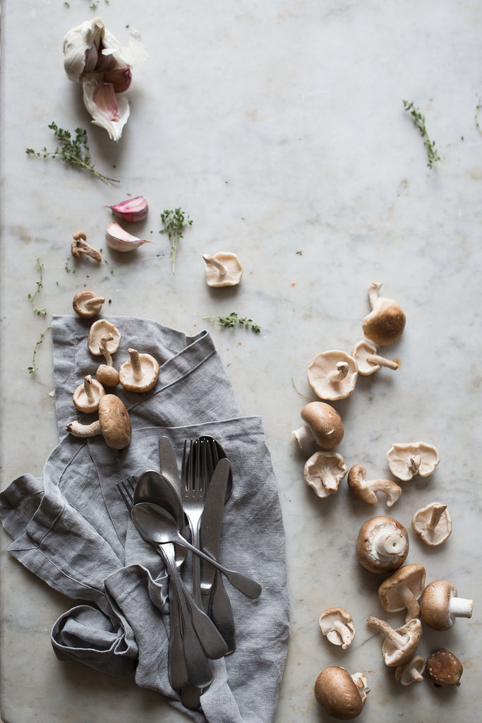 Linen tea towel and mushrooms on marble