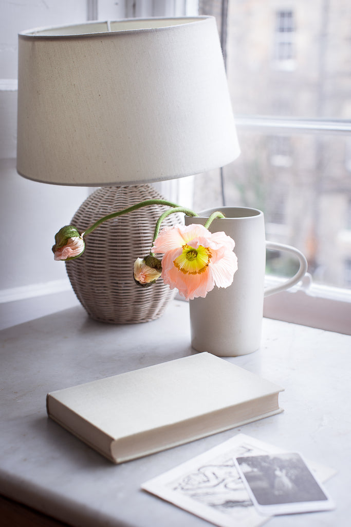 Blush poppies and book on marble desk