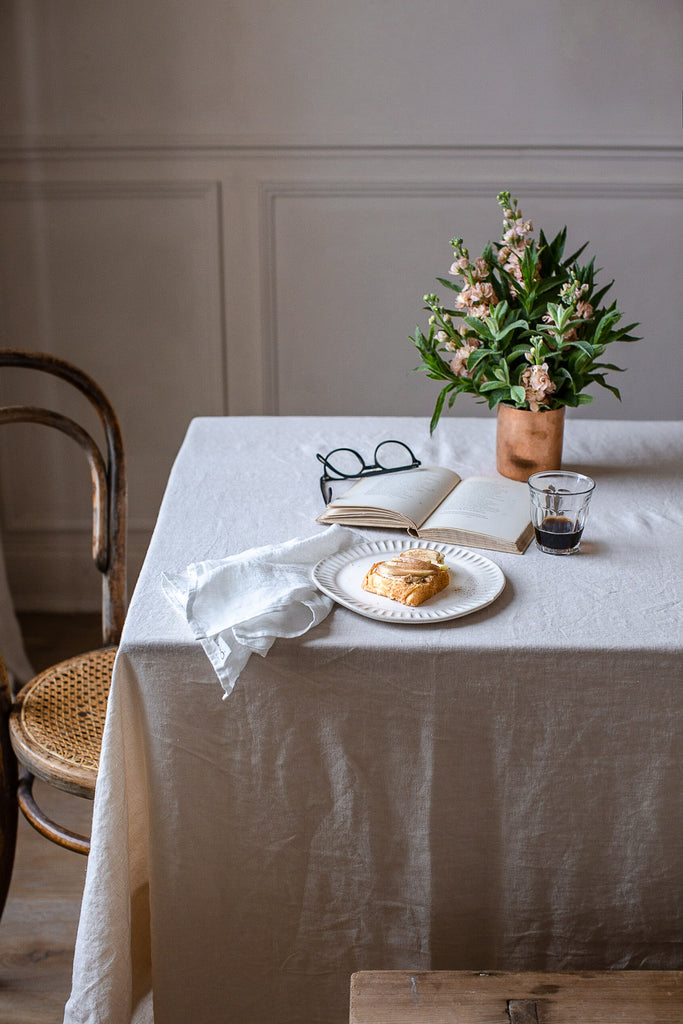 handmade linen tablecloth with wide boarder in warm cream colour