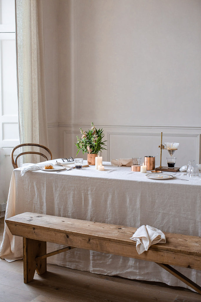 simple natural breakfast table with wood land linen