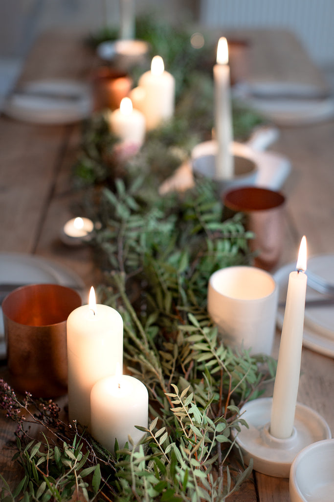 green leaves and copper tablescape with candles