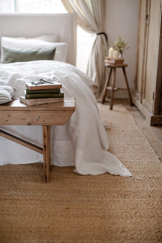 natural bedroom with wood, linen and jute