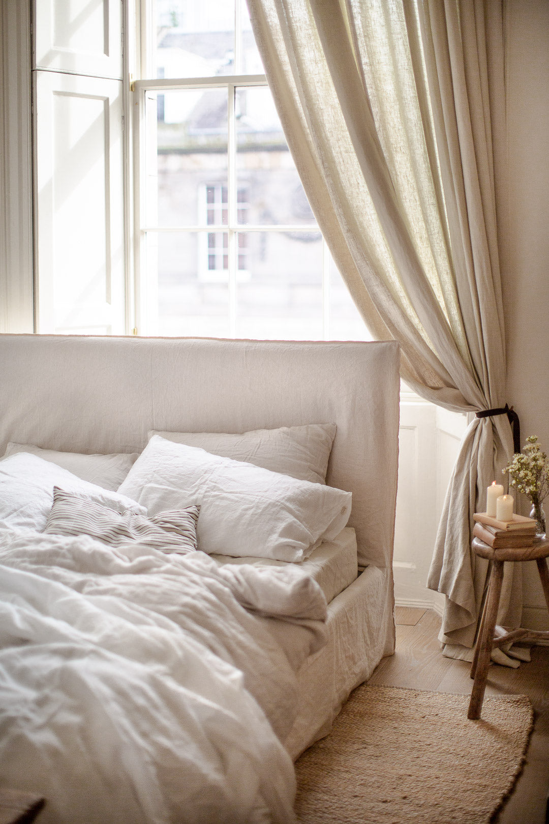 simple neutral bedroom decor with wood and linen