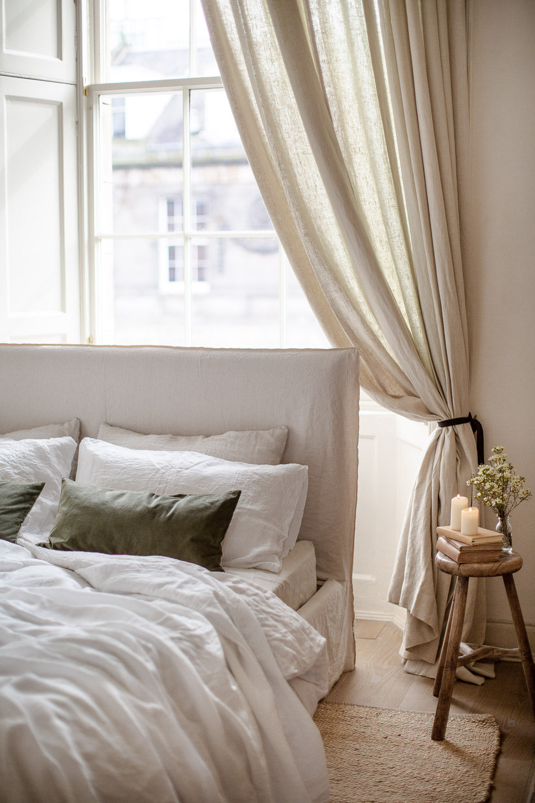 natural bedroom with  cream linen and green velvet