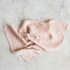 pink linen napkin with frayed edges