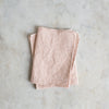 BOTANICAL DYED FRAYED LINEN NAPKIN IN PALE PINK
