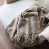 TASSELED HANDWOVEN MERINO WOOL BLANKET IN NATURAL