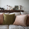 hand dyed sand and green velvet cushions