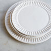 handmade stoneware fluted dinner and side plate in matte white glaze
