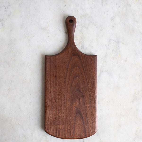 HAND CARVED BLACK WALNUT CUTTING BOARD