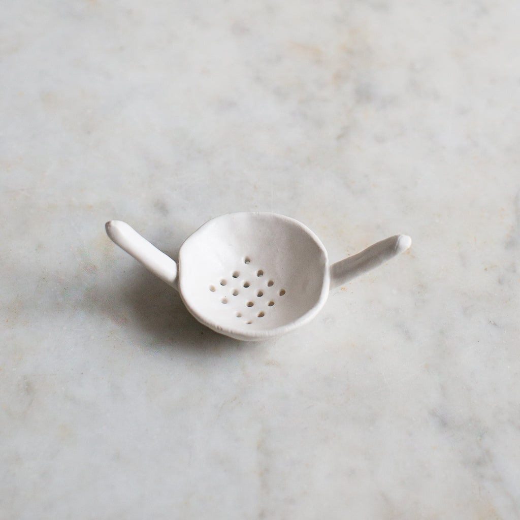 INGREDIENTS LDN tea strainer matte white on ivory