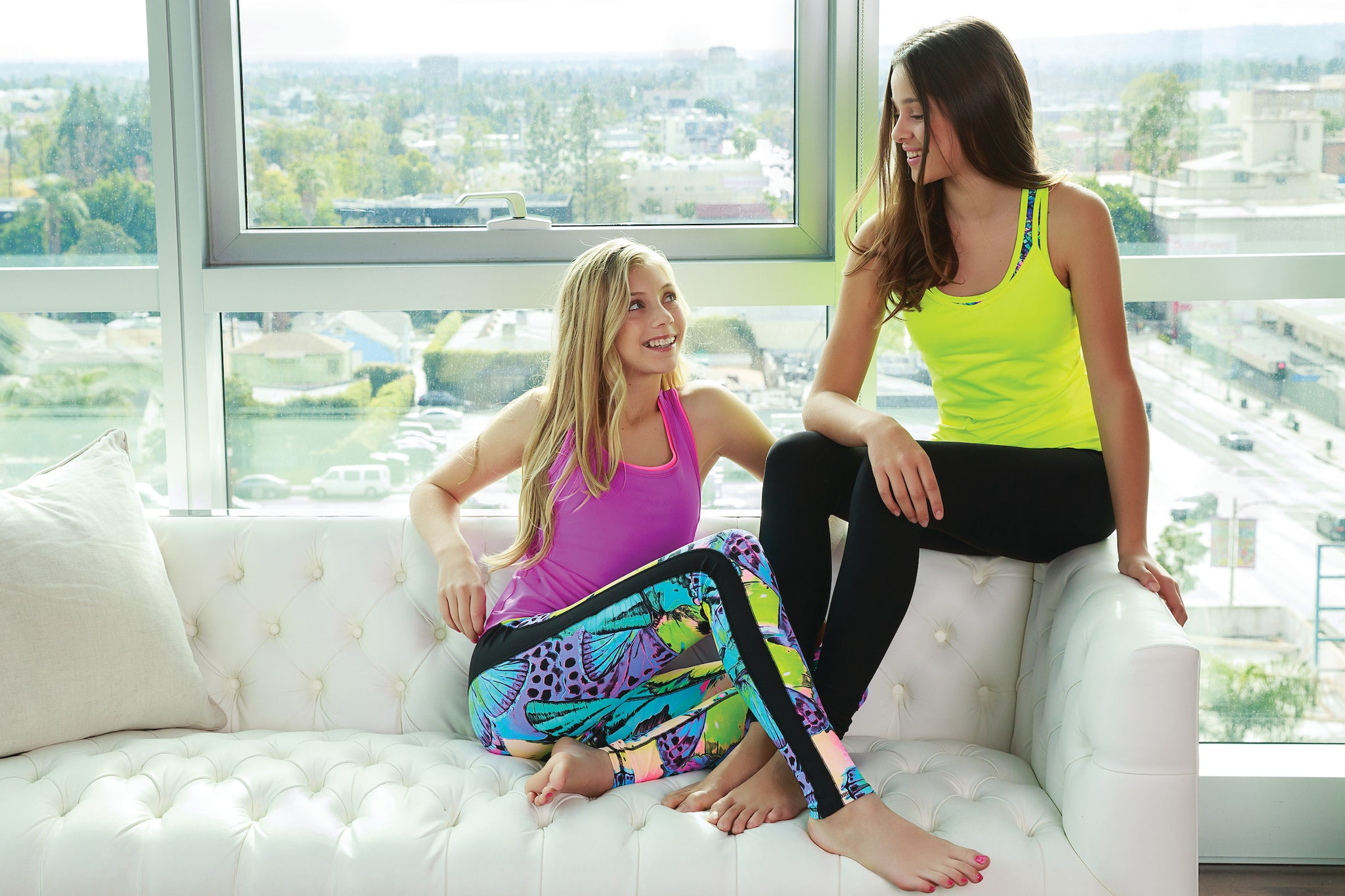 Junior girls on couch in activewear