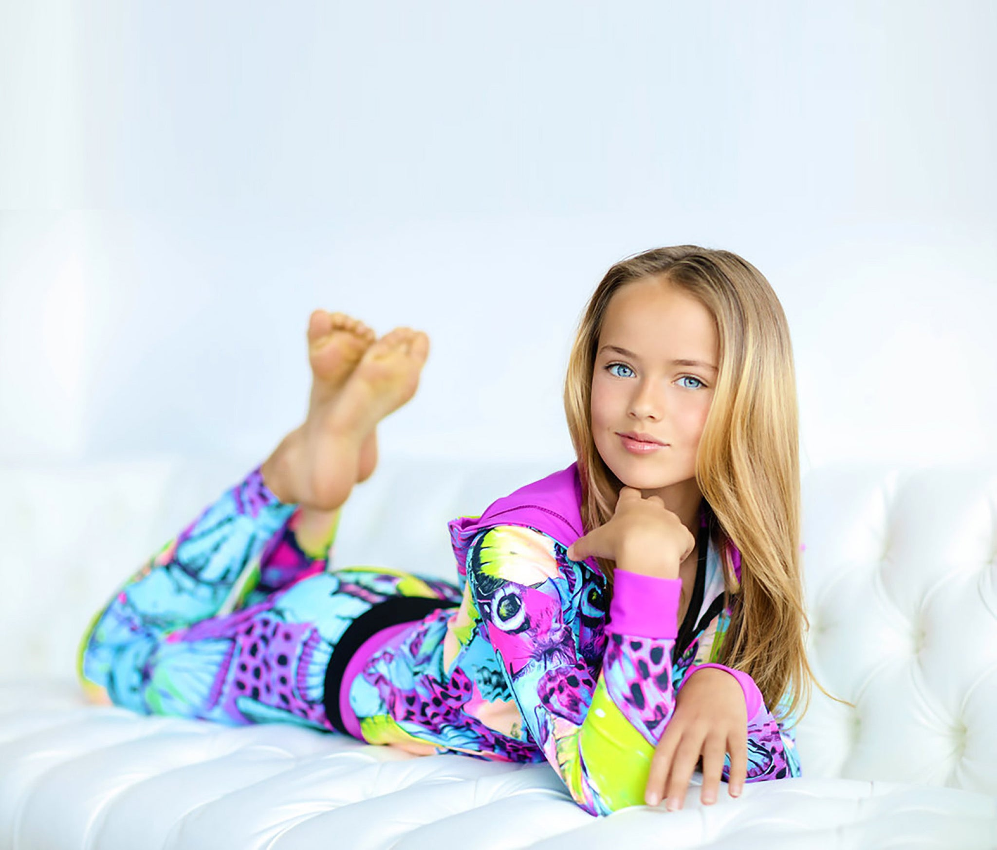 Girl in activewear lying on stomach