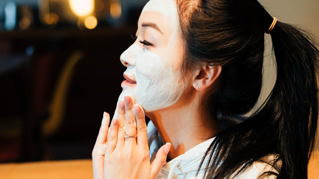 Girl Applying Clay Mask On Face