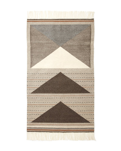 Wild Geese Rug in Grey, with browns, rust and cream