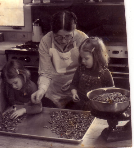 Deanna sorting pecans with children