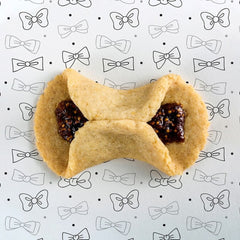 Fig Bow Tie Cookies on a background of bow ties