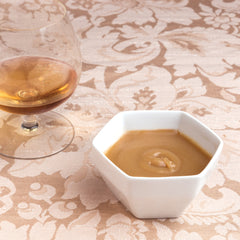 Brandied Butterscotch Sauce in a bowl with snifter