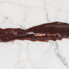 Chocolate Sauce on Marble