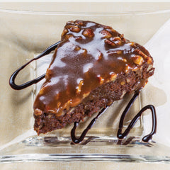 Chocolate Bourbon Pecan Torte Slice on a Plate