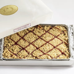 Cranberry Crumble Bar in pan and white gift box.